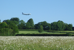 view to the Mendips with plane